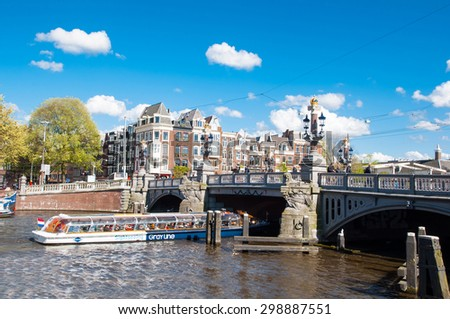 "Amsterdam-April 30: The Blauwbrug on April 30,2015, the Netherlands. The Blauwbrug (literally, ""blue bridge"") is an historic bridge connecting the Rembrandtplein area with the Waterlooplein area. - stock photo"