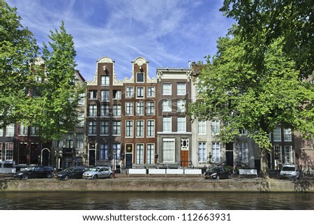AMSTERDAM-AUG. 18, 2012. Ancient gabled mansion on Aug. 18, 2012 in Amsterdam. It is known as Venice of the North, its beautiful canal belt was finally added to the world heritage list in July 2010. - stock photo
