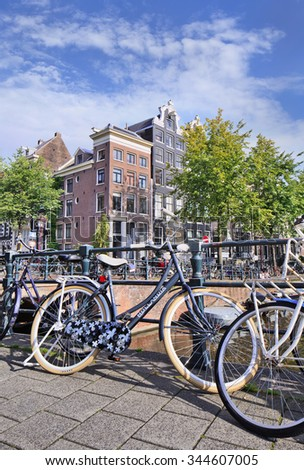 AMSTERDAM-AUG. 27, 2014. Hollandia bike parked against railing. Hollandia (1886) is a Dutch brand. The most important of Dutch bikes is the upright position for good visibility and greater comfort. - stock photo