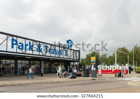 AMSTERDAM - AUGUST 28, 2015: Unknown people in front of one of the many parking lots around Schiphol international airport