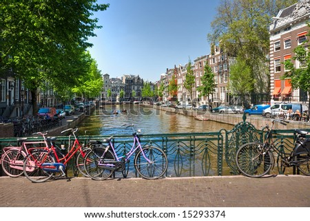 Amsterdam, Canal and bike. Holland. - stock photo