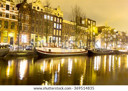 Amsterdam canal at night - stock photo