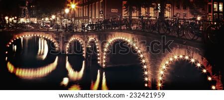 Amsterdam canal bridge night illumination. Netherlands - stock photo