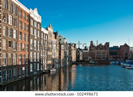 Amsterdam canals and typical houses with clear evening sky - stock photo