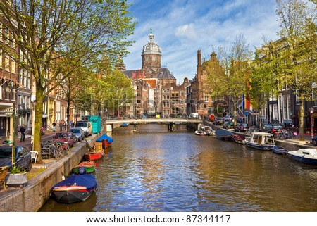 Amsterdam canals in sunny autumn weather - stock photo