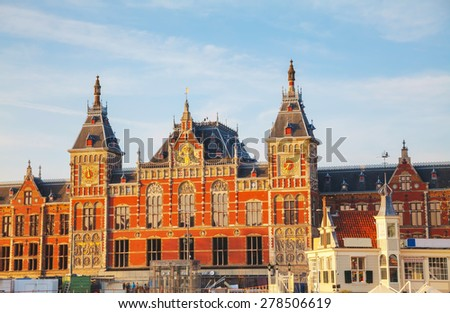 Amsterdam Centraal railway station on a sunny day - stock photo