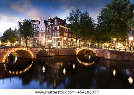 Amsterdam city by night with classified UNESCO canals, Netherlands - stock photo