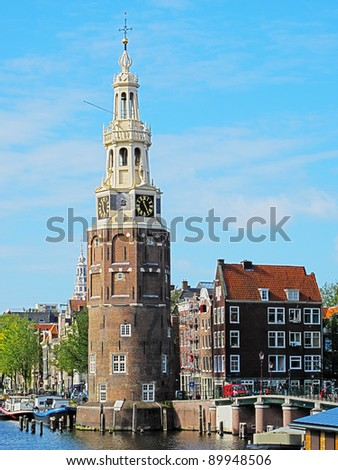 Amsterdam city center with the Montelbaans tower, Netherlands. HDR photo. - stock photo