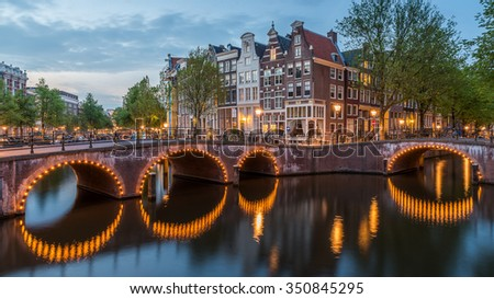 Amsterdam City, Lights, Illuminated Building and Canals at Dusk in Summer Night, Netherlands