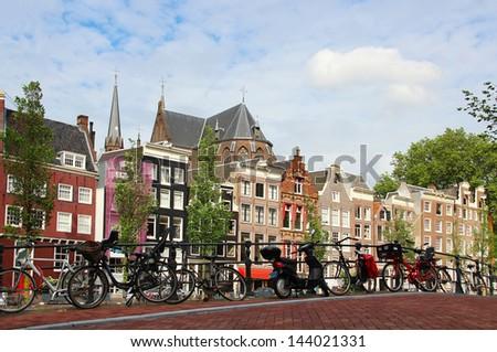 Amsterdam cityscape with bikes on the bridge, Netherlands - stock photo