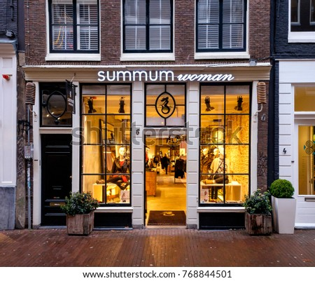 Exterior Of A Small Womens Fashion Boutique With Manekins