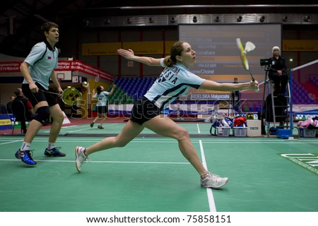 AMSTERDAM - FEBRUARY 19: Evgeniy Dremin and Valeria Sorokina (pictured) beat the Dutch in the quarter-finals of the European Team Championships badminton in Amsterdam, The Netherlands on February 19, 2011. - stock photo