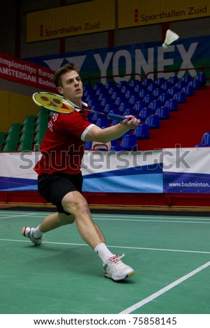 AMSTERDAM - FEBRUARY 17: Hans-Kristian Vittinghus (pictured) beats Tomas Kopriva in the preliminary rounds of the European Team Championships badminton in Amsterdam, The Netherlands on February 17, 2011. - stock photo