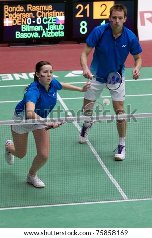 AMSTERDAM - FEBRUARY 17: Jakub Bitman and Alzbeta Basova are beat by the Danish in the preliminary rounds of the European Team Championships badminton in Amsterdam, The Netherlands on February 17, 2011. - stock photo