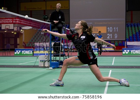 AMSTERDAM - FEBRUARY 19: Juliane Schenk (pictured) beats Ella Diehl in the semi-finals of the European Team Championships badminton in Amsterdam, The Netherlands on February 19, 2011. - stock photo