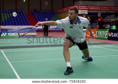 AMSTERDAM - FEBRUARY 19: Marc Zwiebler beats Stanislav Pukhov (pictured) in the semi-finals of the European Team Championships badminton in Amsterdam, The Netherlands on February 19, 2011. - stock photo