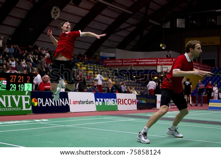 AMSTERDAM - FEBRUARY 20: Mathias Boe and Carsten Mogensen beat the Germans in the finals of the European Team Championships badminton in Amsterdam, The Netherlands on February 20, 2011. - stock photo