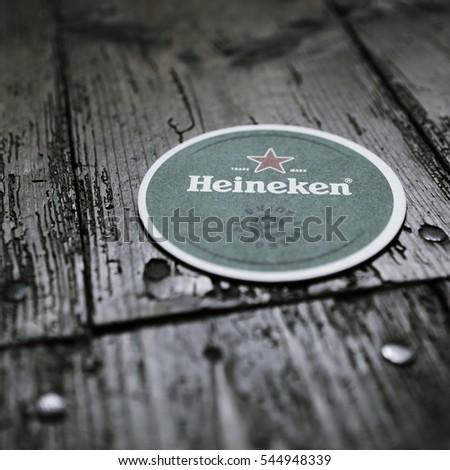 AMSTERDAM, HOLLAND - April 24, 2016.: Beer mats from Heineken Lager Beer in vintage background , it was first brewed by Gerard Adriaan Heineken in 1873