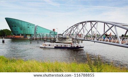 AMSTERDAM, HOLLAND - AUGUST 01: NEMO Science Museum. Nemo building is in the form of a green ship. Nemo was designed by renowned Italian architect Renzo Piano; August 01, 2012 Amsterdam, Holland - stock photo