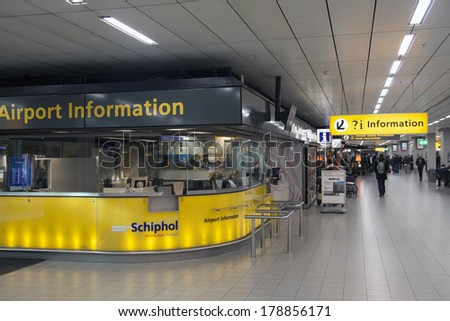 AMSTERDAM,HOLLAND - FEBRUARY 23, 2014: Passenger Information desk at Schiphol Airporton  - stock photo