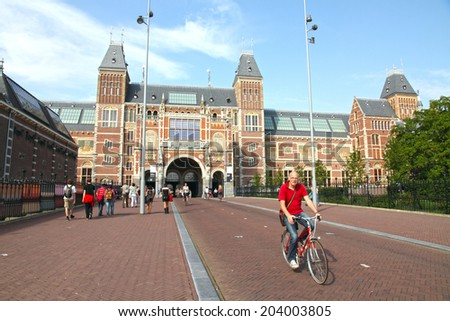 AMSTERDAM HOLLAND-JUNE 7: Rijksmuseum (State Museum), the Dutch national museum dedicated to arts and history on June 7, 2014 in Amsterdam in the Netherlands. - stock photo