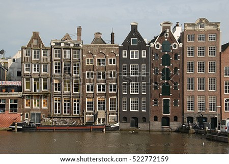 AMSTERDAM, HOLLAND, NETHERLANDS - AUGUST 23, 2007: Typical residential buildings, overlooking a canal, in the city center