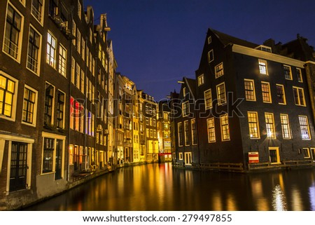 Amsterdam houses in water at night