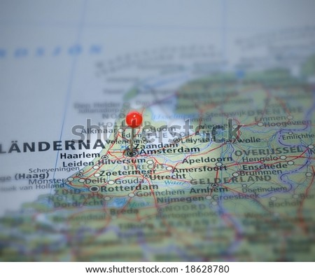 Amsterdam in Nederlands on the map with a pin - stock photo