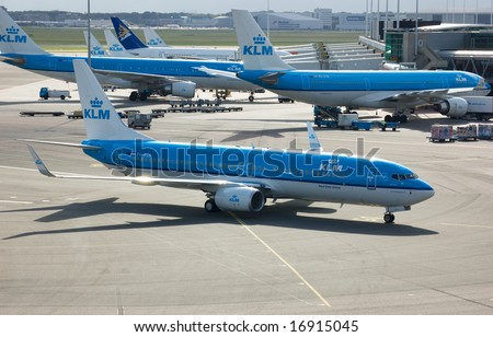 AMSTERDAM - JULY 16: A KLM aircraft taxis to a gate at Amsterdam's Schiphol Airport, the company's hub airport July 16, 2008. - stock photo