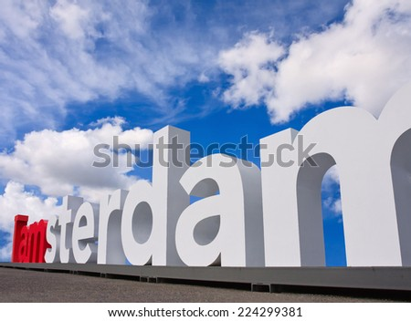 AMSTERDAM-JULY 20, 2009. I Amsterdam logo. The large logo, more than 2 meters tall and over 23.5 meters wide, became a city icon. Visitors photograph themselves, in, around and on top of the slogan. - stock photo