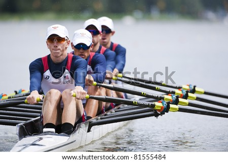 AMSTERDAM - JULY 23:  Newell, Wales, Schultze and O'Leary start for USA in the world championships rowing under 23 in the BLM4x. On July 23, 2011 Bosbaan, Amsterdam, Netherlands - stock photo