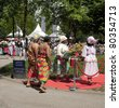 AMSTERDAM - JULY 1:  Representatives of Ghana and Dutch Surinamese community lay wreaths during the official ceremony at the annual Keti Koti  festival, held July 1, 2011 in Amsterdam, The Netherlands - stock photo