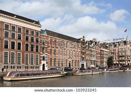 AMSTERDAM-JULY 20: Seventeenth century mansions on July 20, 2009 in Amsterdam, The Netherlands More than 100 KM of 17th-century canals in the heart of Amsterdam, were added to the UNESCO World Heritage List in 2010. - stock photo