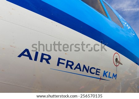 AMSTERDAM - 19 JULY, 2014: The Air France KLM company name written on a Cityhopper Fokker 70 with reflection of boarding travellers. - stock photo