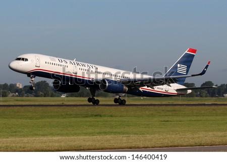 AMSTERDAM - JULY 02: US Airways Boeing B757-2B7 lands at AMS Airport in Netherlands on July 02, 2012. US Airways is a major U.S. airline. - stock photo