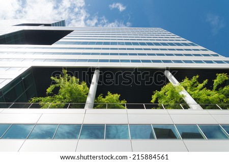 AMSTERDAM - JUNE 7, 2014: One of the towers of the Amsterdam WTC with a green ecological floor. It is a commercial center in the Amsterdam South Axis, with over 125,000 square meter of office space. - stock photo