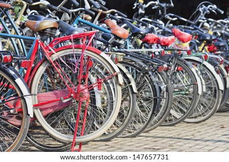 AMSTERDAM-MARCH 21. Bicycle storage. Bicycles outnumber the people in Amsterdam: 760,000 citizens and nearly a million bikes. There are also twice as many bikes then cars. Amsterdam, March 21, 2013. - stock photo