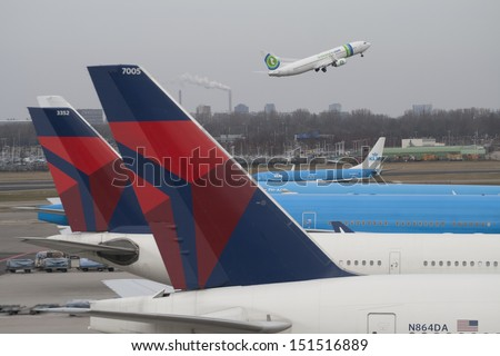 AMSTERDAM, MARCH 3 : KLM and Delta airlines planes at Schiphol Airport march 3, 2013 in Amsterdam,The Netherlands. - stock photo