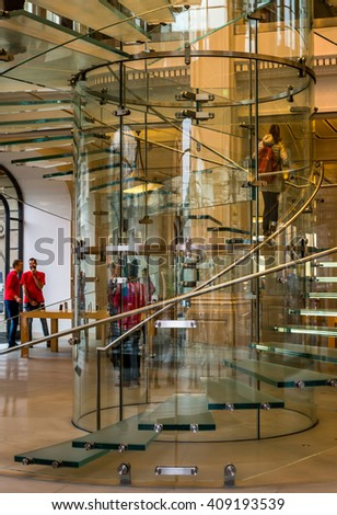 AMSTERDAM, NETHARLANDS - DECEMBER 06, 2015 : Glass round stairs at Apple store in Amsterdam, Netherlands.