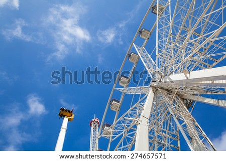 AMSTERDAM, NETHERLANDS, April, 23 - Amusement park on Dam Square (Royal Square) of Amsterdam. Amsterdam, Netherlands, April 23, 2015 - stock photo