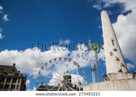 AMSTERDAM, NETHERLANDS, April, 27 - Attractions park on Dam Square (Royal Square) of Amsterdam. Amsterdam, Netherlands, April 27, 2015 - stock photo