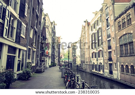 Amsterdam, Netherlands.-APRIL 23: Traditional old buildings on April 23, 2014. Beautiful street view of Traditional old buildings in Amsterdam, the Netherlands  - stock photo