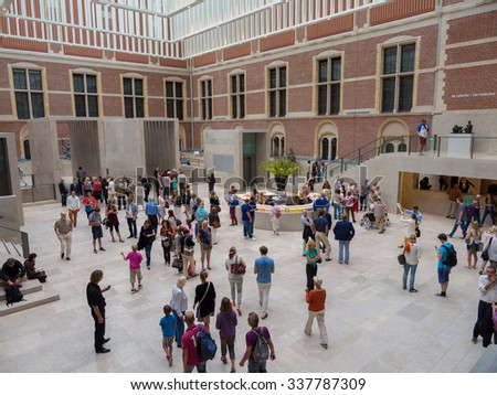 AMSTERDAM, NETHERLANDS - AUG 30: Rijksmuseum in Amsterdam, Netherlands on August 30, 2013. Amsterdam is the capital city and most populous city of the Kingdom of the Netherlands. - stock photo