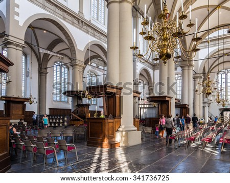 AMSTERDAM, NETHERLANDS - AUG 26: Westerkerk church in Amsterdam, Netherlands on August 26, 2013. Amsterdam is the capital city and most populous city of the Kingdom of the Netherlands. - stock photo