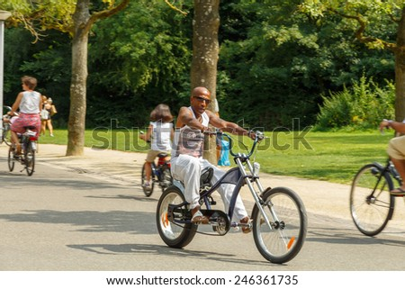 Amsterdam, Netherlands - August 5, 2014:  Cyclists on the cycling road Vondelpark in Amsterdam.