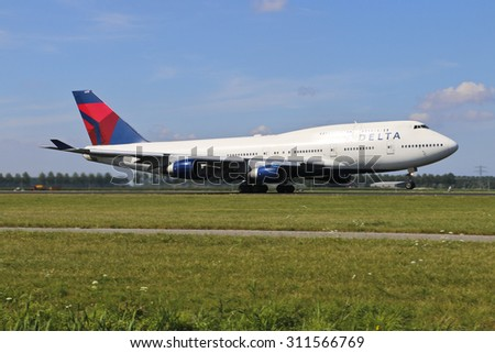 AMSTERDAM, NETHERLANDS - August 9, 2015: Delta Airlines, Boeing 747 Jumbo aircraft taking off at Schipol International Airport, The Netherlands - stock photo