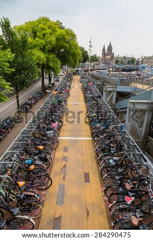 AMSTERDAM, NETHERLANDS - AUGUST 19: Huge bicycle parking in the center of Amsterdam  on August 19, 2014 - stock photo