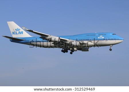 AMSTERDAM, NETHERLANDS - August 9, 2015: KLM Boeing 747 Jumbo Jet landing at Schipol International Airport, The Netherlands - stock photo