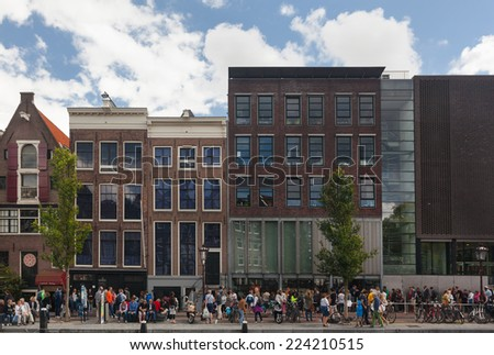 AMSTERDAM - NETHERLANDS: AUGUST 13, 2014: People waiting in line in front of the Anne Frank House, one of Amsterdam's most popular tourist attraction. - stock photo