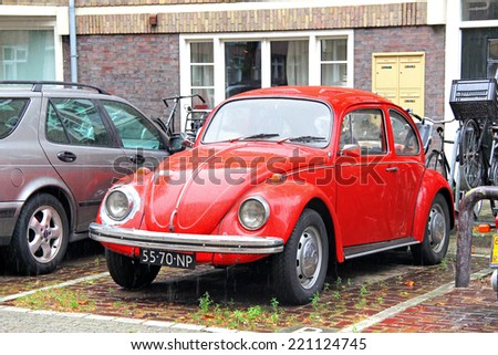 AMSTERDAM, NETHERLANDS - AUGUST 10, 2014: Retro car Volkswagen Beetle at the city street. - stock photo